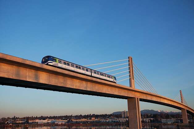 The Canada Line SkyTrain crossing a bridge over the Fraser River between Richmond and Vancouver. Photo: Albert Normandin, Tourism B.C.