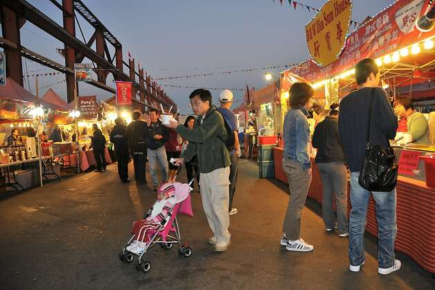 The Summer Night Market in Richmond, B.C., on a 10-acre site, is where more than 20,000 visitors nightly stream in as the sun goes down. Photo: Margo Pfeiff, Special To The Chronicle