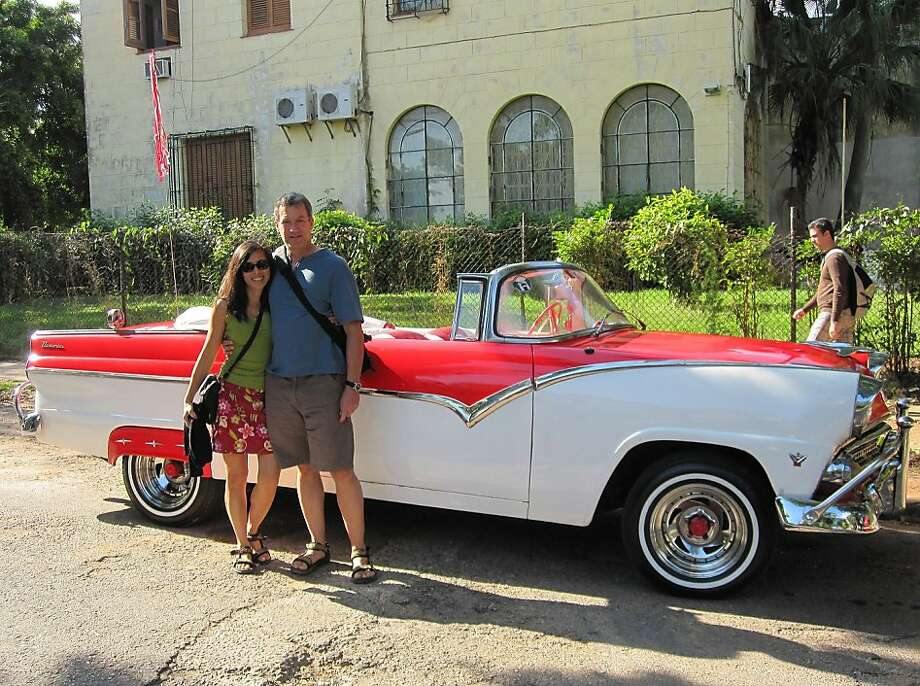 Carla Din and Doug Mosher of Oakland in front of a vintage car in Havana, Cuba. Photo: Courtesy Carla Din