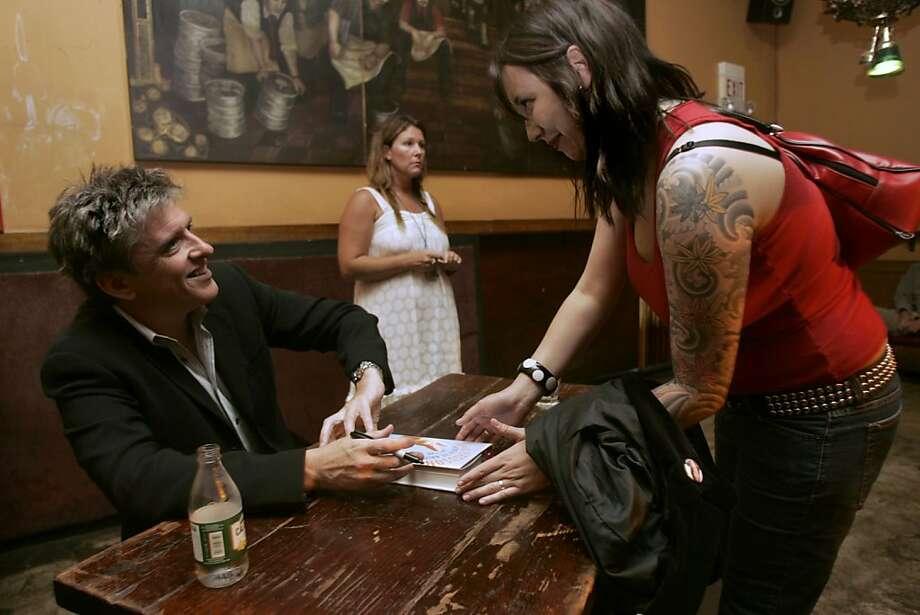 Comedian Craig Ferguson signs autographs at the Edinburgh Castle pub in San Francisco. Photo: Liz Hafalia, SFC
