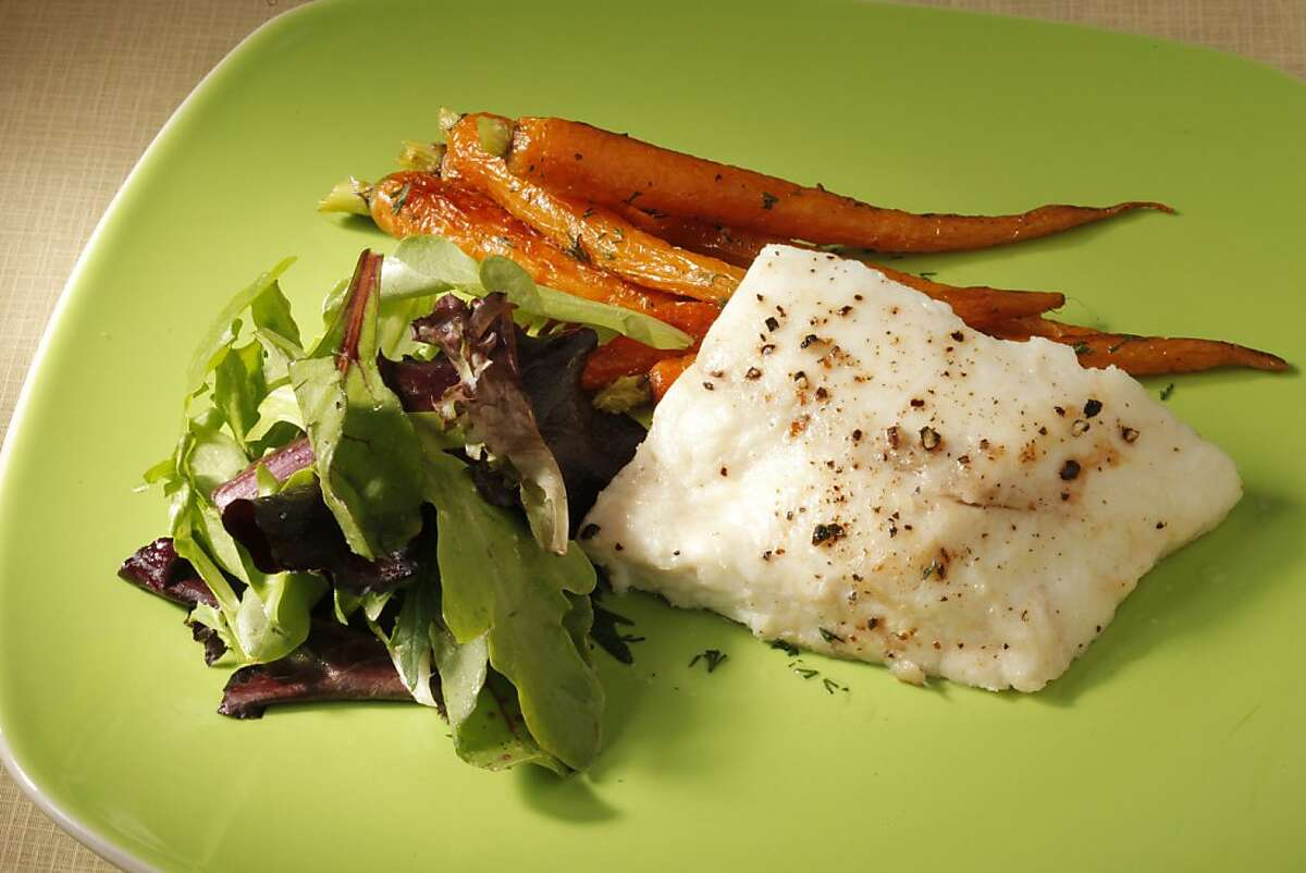 Olive Oil-Poached Halibut with Dill-Roasted Carrots as seen in San Francisco on March 7, 2011. Food styled by Amanda Gold.