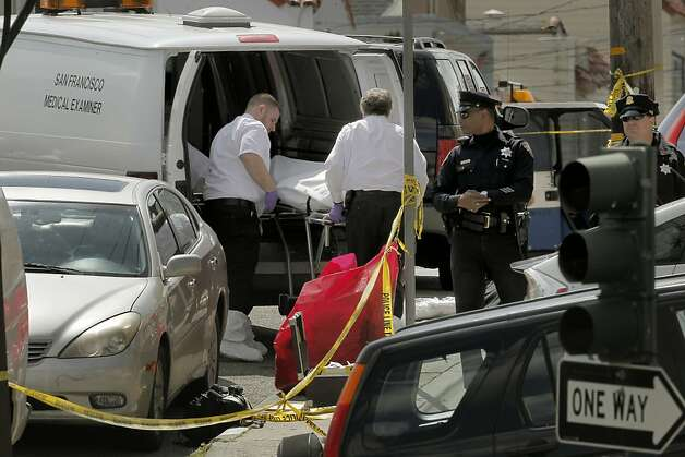 The San Francisco Medical Examiner removes the second of five bodies, at the scene of what is believed to be a murder suicide,  at 16 Howth St. near Ocean Ave., where five people were found dead inside the home, on Friday March 23, 2012, in San Francisco, Ca. Photo: Michael Macor, The Chronicle