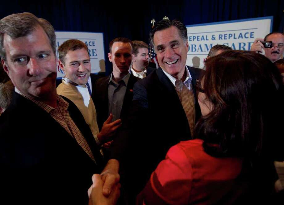 Republican presidential candidate, former Massachusetts Gov. Mitt Romney, greets supporters during a campaign stop in Metairie, La., Friday, March 23, 2012. (AP Photo/Steven Senne) Photo: Steven Senne / AP