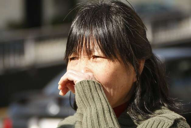 Chan-Fong Lin, a nearby resident,  reacts to learning that five people were found dead at 16 Howth Street near City College in San Francisco, Ca.  Officials are investigating the case. Photo: Siana Hristova, The Chronicle