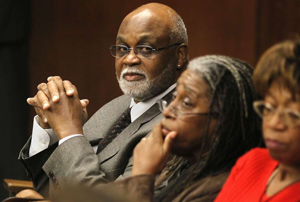 With his wife, Diane benton, (center) and sister Connie Bridgeforth waiting for the hearing to begin, Ronald Bridgeforth prepares to surrender himself on a 42 year old arrest warrant on Thursday November 10, 2011 in San Mateo County Court in Redwood City, Ca. Bridgeforth, under charges of assault with a deadly weapon on a San Francisco police officer 42 years ago, jumped bail and fled, has now returned to face the charges against him.