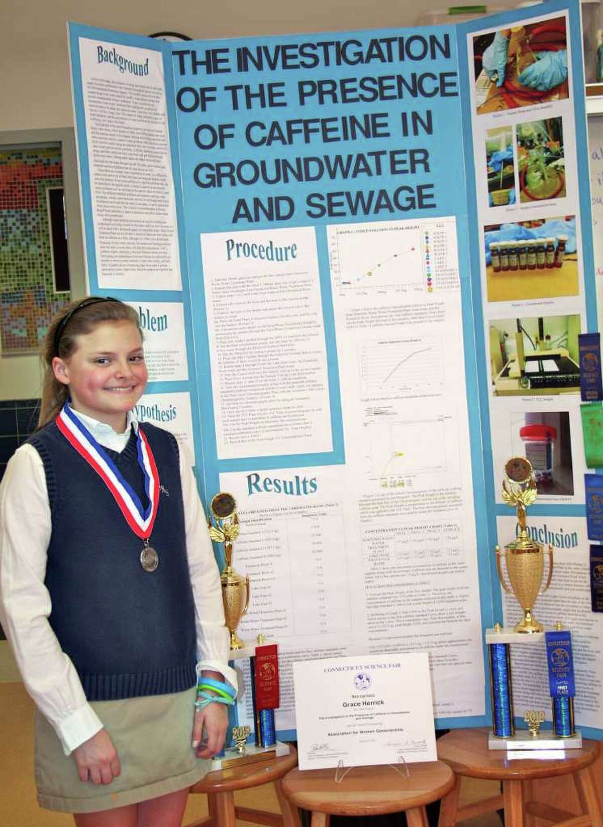 Grace Herrick, 13-year-old seventh grader at St. Rose of Lima School in Newtown won first place for middle school projects at the Connecticut Science Fair at Quinnipiac University in Hamden March 17.
