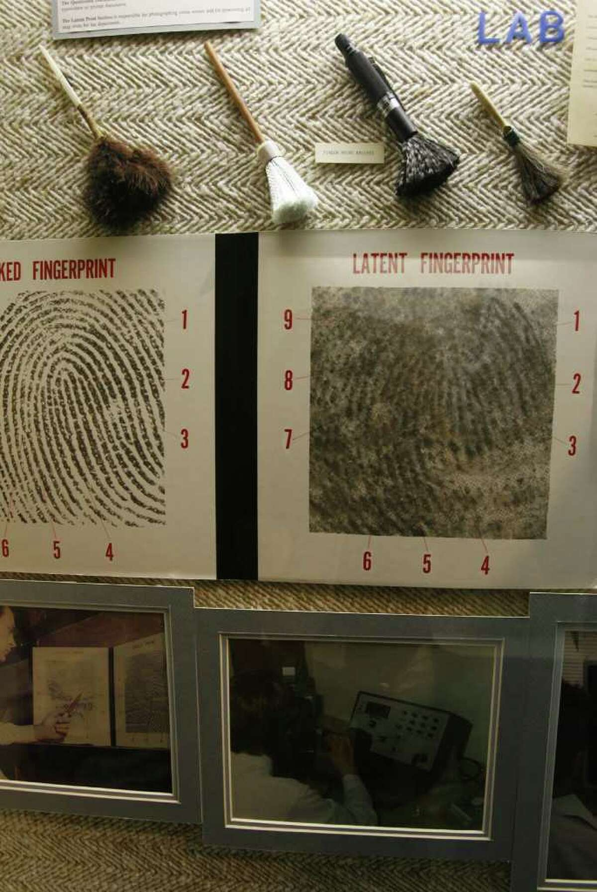 Crime lab brushes and fingerprints are on display at the Houston Police Department's museum, which is located inside the department's Police Academy.