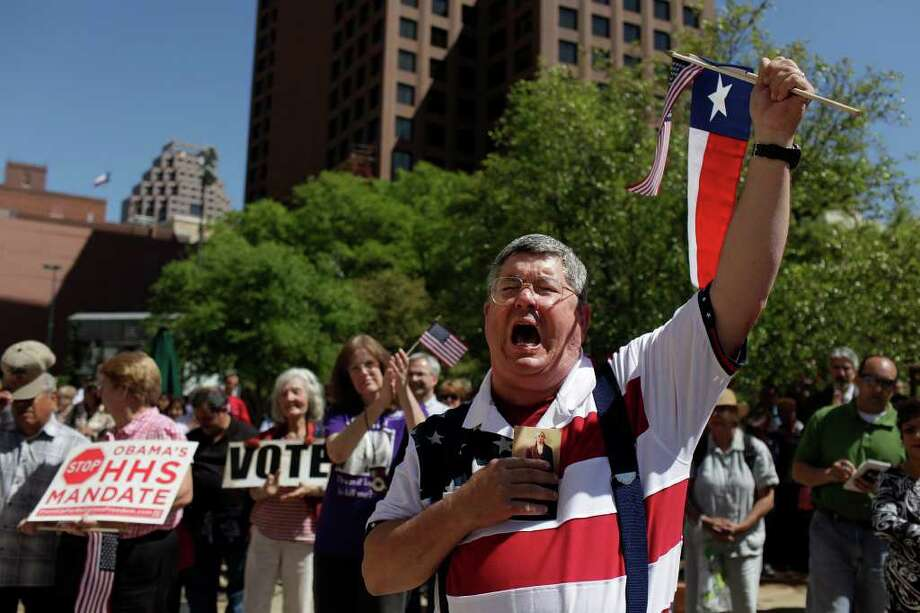 Pat Denzer cheers after the opening prayer during the Stand Up for Religious Freedom Rally on Main Plaza in front of San Fernando Cathedral on Friday, March 23, 2012. Photo: Lisa Krantz, San Antonio Express-News / @San Antonio Express-News