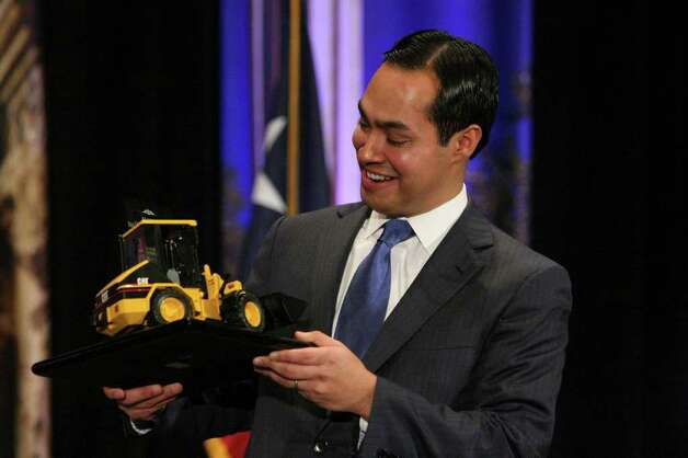 Mayor Julian Castro holds a front end loader given to him as a gift after his annual State of the City address to San Antonio's chambers of commerce on Friday March 23, 2012. Photo: HELEN L. MONTOYA, San Antonio Express-News / ©SAN ANTONIO EXPRESS-NEWS