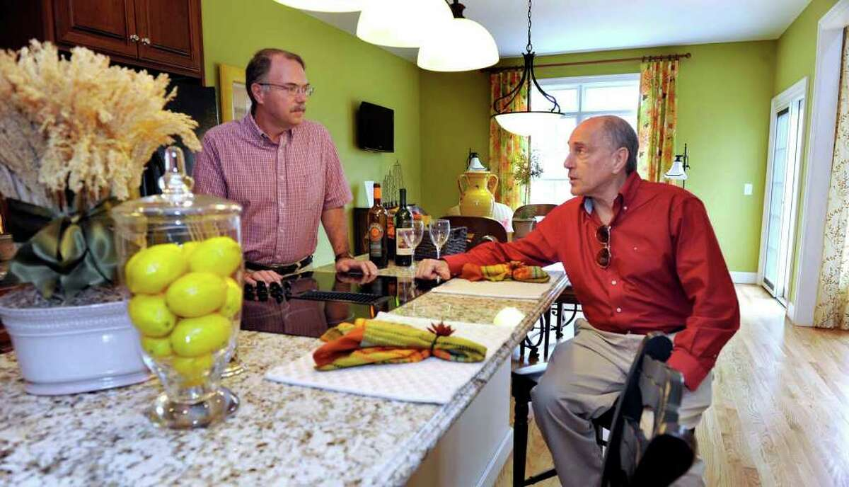 Martin Handshy, left, of Ridgefield, and Dennis Stone, of Brookfield, are the developers of Newbury Village, an adult community on Route 7 in Brookfield.