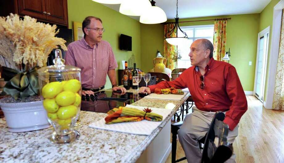 Martin Handshy, left, of Ridgefield, and Dennis Stone, of Brookfield, are the developers of Newbury Village, an adult community on Route 7 in Brookfield. Photo: Carol Kaliff / The News-Times
