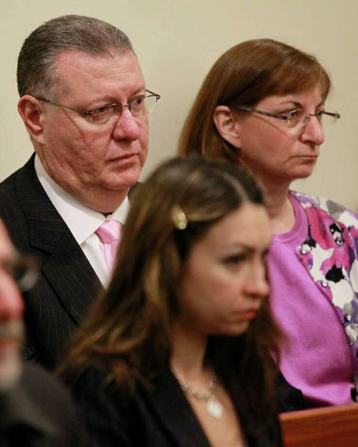 FILE - In this May 23, 2011 file photo, Joe Clementi, top left, and his wife, Jane, right, sit inside Judge Glenn Berman's courtroom at the Middlesex County Courthouse during a hearing for Dharun Ravi, in the webcam-spying case involving the suicide of their son Tyler Clementi, in New Brunswick, N.J. Joe and Jane Clementi said Friday, March 23, 2012, that a jury got it right last week by convicting their son's roommate, Ravi, of hate crimes and other offenses. (AP Photo/Julio Cortez, File) Photo: Julio Cortez