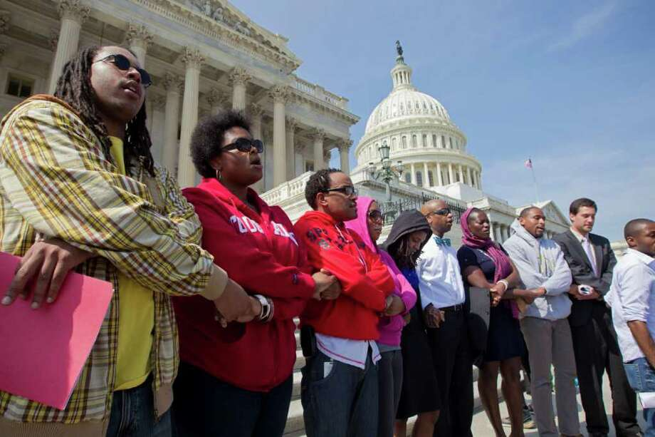 Congressional staff members and others gather on Capitol Hill to remember Trayvon Martin, the unarmed black teenager who was shot to death in Sanford, Fla., while wearing a hooded sweatshirt. Photo: J. Scott Applewhite / AP