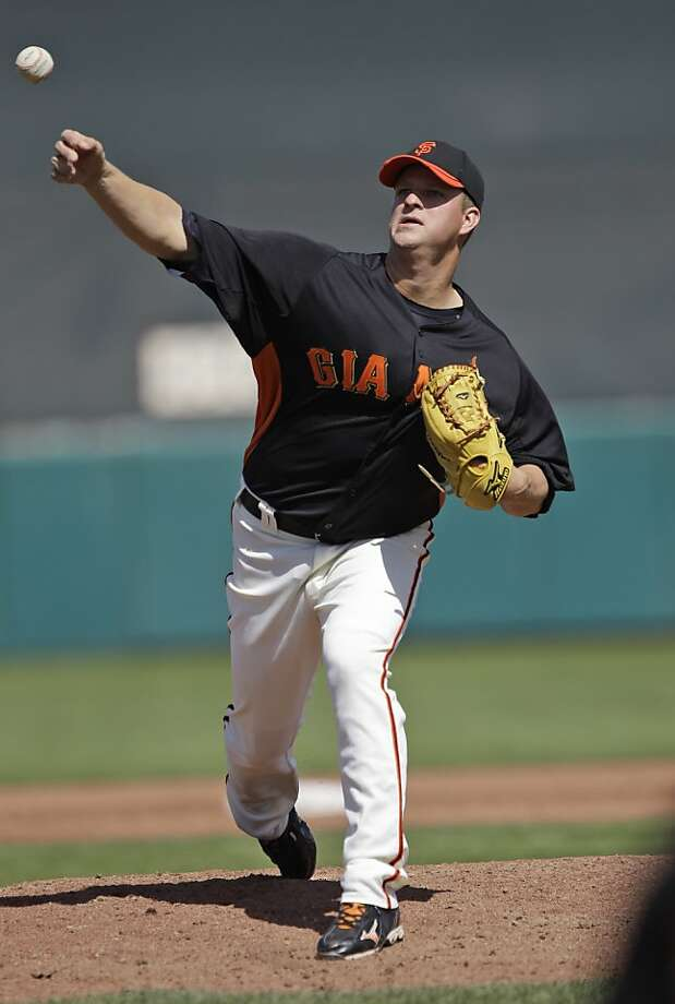 San Francisco Giants starting pitcher Matt Cain throws to the Cincinnati Reds during the third inning of a spring training baseball game Friday, March 9, 2012 in Scottsdale, Ariz. (AP Photo/Marcio Jose Sanchez) Photo: Marcio Jose Sanchez, Associated Press