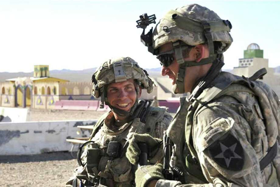 This August 2011 U.S. military photo shows Staff Sgt. Robert Bales, left, at a training center in California. Photo: SPC. RYAN HALLOCK / AFP