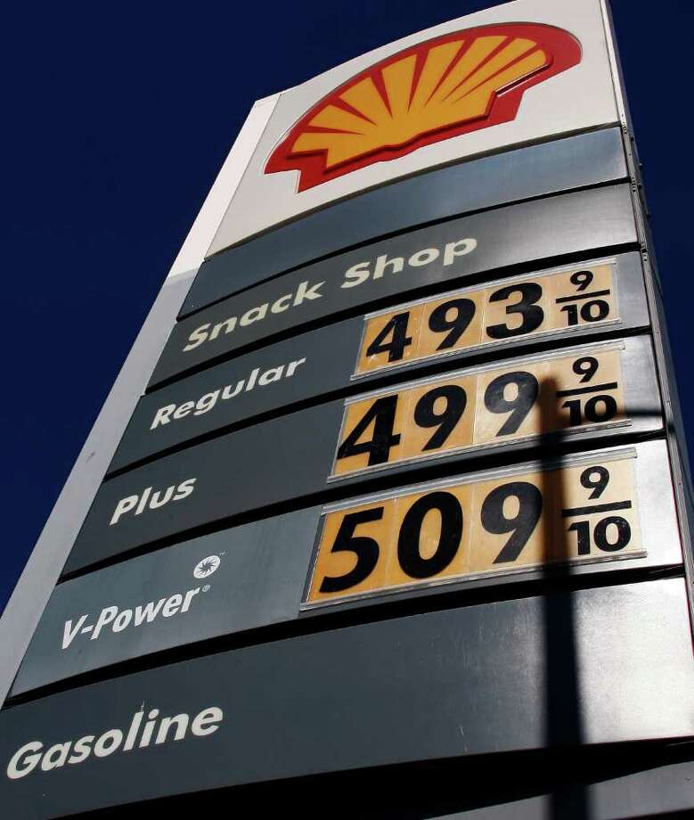 Prices for self-serve and mid-grade are well over $4.00 per gallon, and exceed $5.00 for premium at a Shell station in the Wilshire district of Los Angeles Wednesday, March 21, 2012. From all corners of the country, people report being poorer and angrier these days, thanks to the record-high price of fuel that has been gripping the nation. The steady rise in gas prices, which now top $4 a gallon in several states, has become one of the hottest issues in the country just as the nation heads into both its peak driving season and a presidential campaign. (AP Photo/Reed Saxon) Photo: Reed Saxon