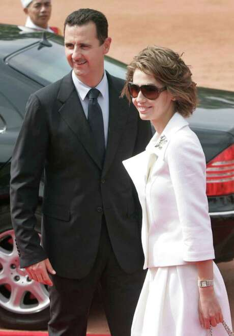Syrian first lady, Asma Assad, is accused of shopping online for designer shoes while her husband, Bashar, unleashed deadly forces on civilians. Photo: Gurinder Osan / AP