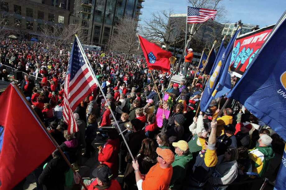 FILE - In this March 10, 2012, file photo, labor groups and others rally in front of the state capitol building in Madison, Wis. to recall Wisconsin Gov. Scott Walker. The effort to recall Walker has been so all-encompassing in Wisconsin, voters and GOP operatives admit to being distracted to the point of not even caring much about the upcoming April 3 presidential primary.  (AP Photo/Wisconsin State Journal, Craig Schreiner, File) Photo: Craig Schreiner / Wisconsin State Journal