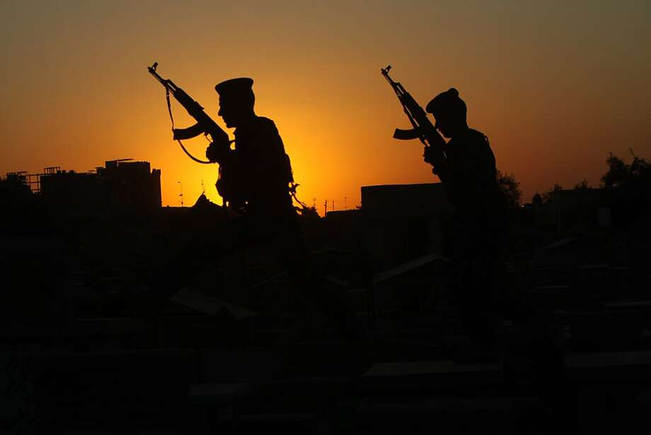 Iraqi security forces patrol in the cemetery in the Shiite holy city of Najaf, 160 kilometers (100 miles) south of Baghdad, Iraq, Thursday, March 22, 2012. The Iraqi government has tightened its security measures as al-Qaida's front group in Iraq claimed Wednesday it was behind a wave of attacks to how weak the nation's security is heading into next week's Arab League summit in Baghdad. (AP Photo/Alaa al-Marjani) Photo: Alaa Al-Marjani, Associated Press