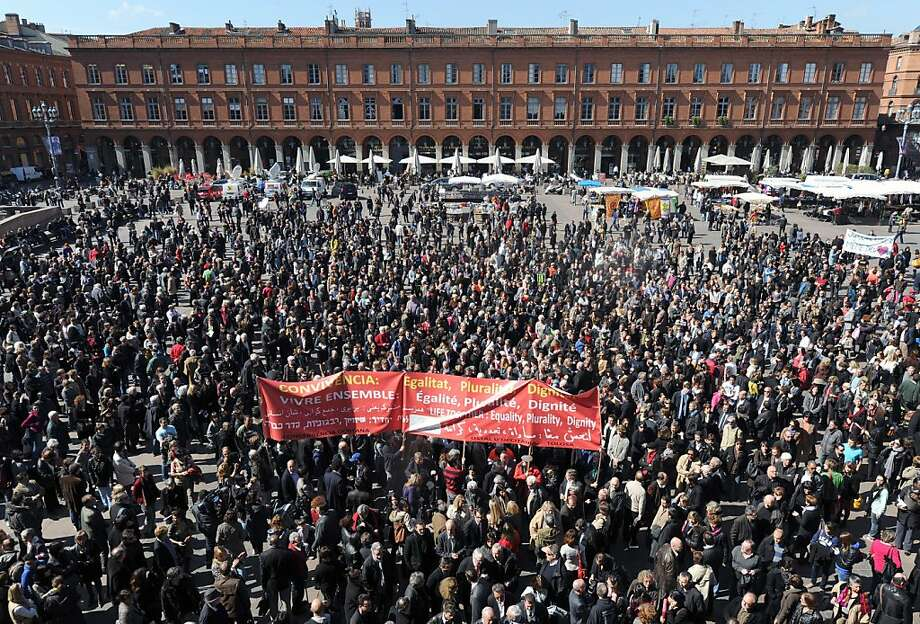 Hundreds of people gather on March 23, 2012 on the main public Capitole square in the southwestern French city of Toulouse to pay homage to the seven victims of the self-proclaimed Al-Qaeda militant Mohamed Merah. President Nicolas Sarkozy announced in the immediate aftermath of 23-year-old Merah's attacks and violent end that France would take measures to stamp-out extremist proselytising in prisons.  French police on Friday prolonged the detention of the mother and brother of the self-proclaimed Islamic extremist who killed seven people before being shot dead. Photo: Eric Cabanis, AFP/Getty Images