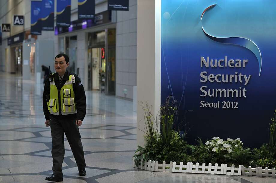 A policeman walks past a sign for the 2012 Seoul Nuclear Security Summit at the venue in Seoul on March 23, 2012.  Leaders from over 50 nations will converge on the South Korean capital for the summit on March 26-27. Photo: Nicolas Asfouri, AFP/Getty Images