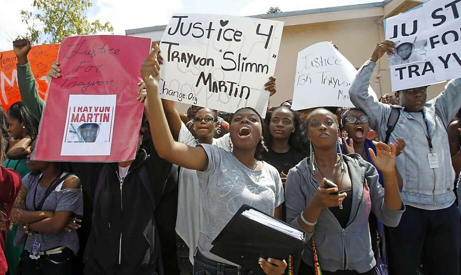 Michael M. Krop Senior High School students carry signs and chant during a rally demanding justice for Trayvon Martin, Friday, March 23, 2012, in Miami Gardens, Fla. Martin was slain in the town of Sanford, Fla., on Feb. 26 in a shooting that has set off a nationwide furor over race and justice. Neighborhood crime-watch captain George Zimmerman claimed self-defense and has not been arrested, though state and federal authorities are still investigating. Photo: Alan Diaz, Associated Press