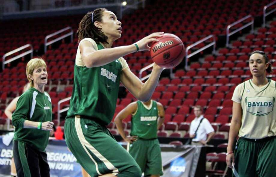 Baylor coach Kim Mulkey, left, instructs star player Brittney Griner, center, during practice Friday. Photo: Nati Harnik