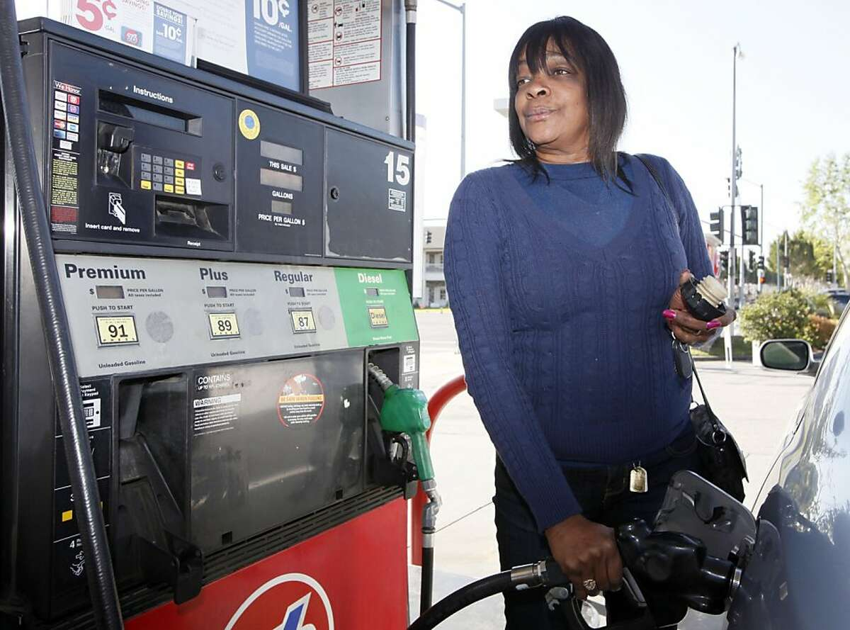 Rosalyn Buchanan fills her tank with gas at a station in Arcadia, Calif., Tuesday, March 20, 2012. From all corners of the country, Americans are poorer and angrier these days, thanks to the record fuel prices that have soared above $4 a gallon in some states and could top $5 by summer.(AP Photo/Nick Ut)