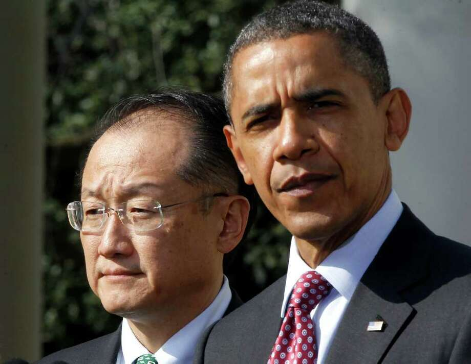President Barack Obama stands with Jim Yong Kim, his nominee to be the next World Bank President, in the Rose Garden of the White House in Washington, Friday, March 23, 2012. Kim is currently the president of Dartmouth College. (AP Photo/Charles Dharapak) Photo: Charles Dharapak