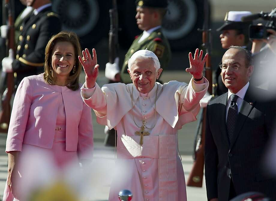 Pope Benedict XVI (C) waves next to Mexican President Felipe Calderon and his wife Margarita Zavala, upon his arrival at Silao's international airport in Guanajuato, Mexico, on March 23, 2012. The Pope arrived in Mexico for his first trip to Spanish-speaking Latin America which will also include a two-day visit to Cuba. Photo: Ronaldo Schemidt, AFP/Getty Images