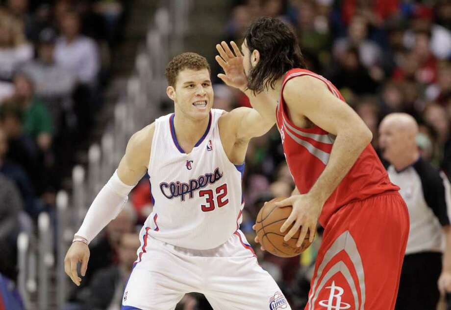 The Clippers' Blake Griffin tries to keep the Rockets' Luis Scola from making one more pass Saturday. Photo: Jae C. Hong / AP