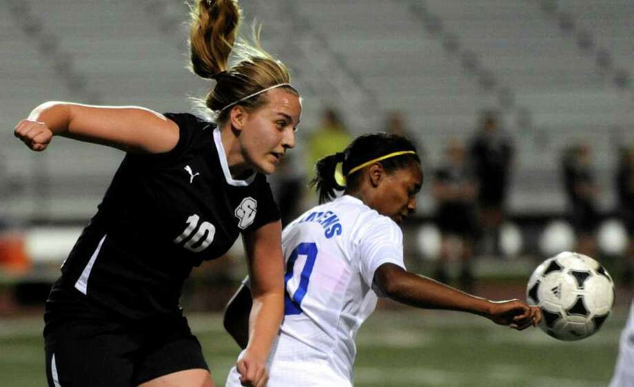 Smithson Valley's Mariah Burt, left, and Senait Gordon of Clemens chase the ball during girls soccer action at Clemens High School on Friday, March 23, 2012. Billy Calzada / San Antonio Express-News Photo: Billy Calzada, Express-News / San Antonio Express-News