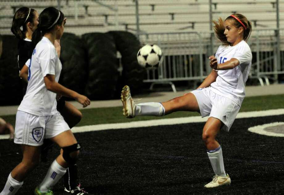 Emma Gibson of Clemens kicks the ball during soccer action against Smithson Valley at Clemens High School on Friday, March 23, 2012. Billy Calzada / San Antonio Express-News Photo: Billy Calzada, Express-News / San Antonio Express-News