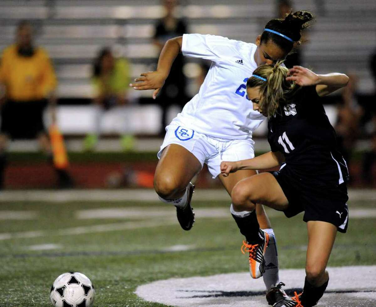 Maya Westbrook of Clemens, left, and Gabby Rodriguez of Smithson Valley battle during girls soccer action at Clemens High School on Friday, March 23, 2012. Billy Calzada / San Antonio Express-News