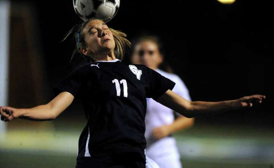 Gabby Rodriguez of Smithson Valley heads the ball during girls soccer action against Clemens at Clemens High School on Friday, March 23, 2012. Billy Calzada / San Antonio Express-News Photo: Billy Calzada, Express-News / San Antonio Express-News