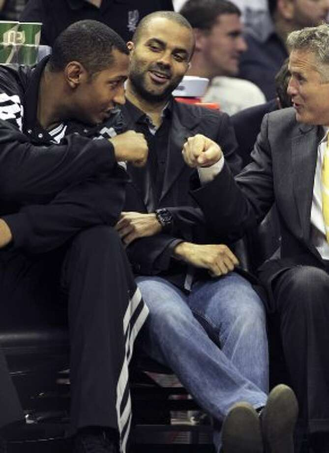 Boris Diaw is accepted on the bench by coach Brett Brown and Tony Parker as the Spurs play the Dallas Mavericks at the AT&T Center in San Antonio on March 23, 2012.  Tom Reel/ San Antonio Express-News (TOM REEL / San Antonio Express-News)