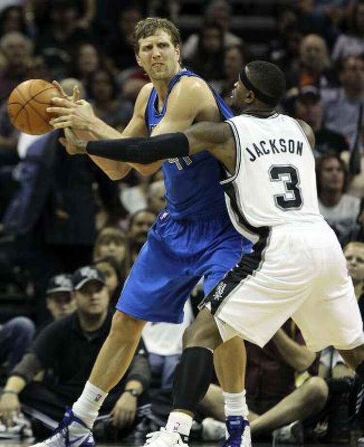 Stephen Jackson reaches in and tips the ball away from Dirk Nowitzki resulting in a fast break score by Manu Ginobili as the Spurs play the Dallas Mavericks at the AT&T Center in San Antonio on March 23, 2012.  Tom Reel/ San Antonio Express-News (TOM REEL / San Antonio Express-News)