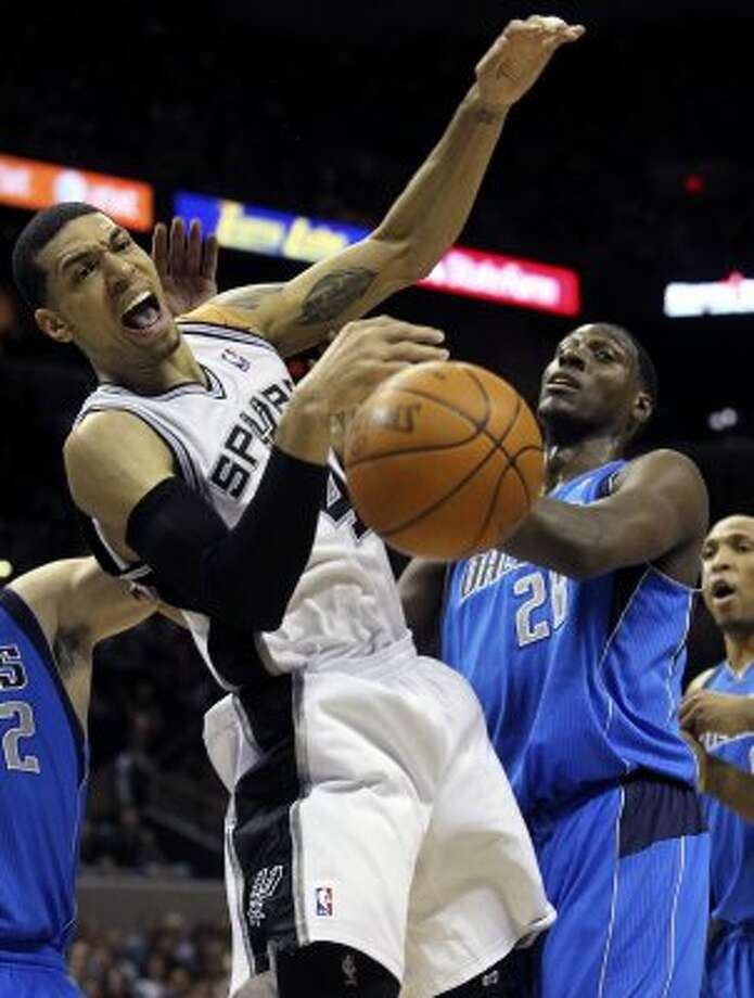 Danny Green loses the ball after being fouled in the lane as the Spurs play the Dallas Mavericks at the AT&T Center in San Antonio on March 23, 2012.  Tom Reel/ San Antonio Express-News (TOM REEL / San Antonio Express-News)