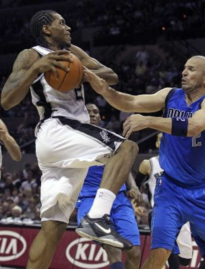 Kawhi Leonard rolls in to score on a fast break against Jason Kidd as the Spurs play the Dallas Mavericks at the AT&T Center in San Antonio on March 23, 2012.  Tom Reel/ San Antonio Express-News (TOM REEL / San Antonio Express-News)