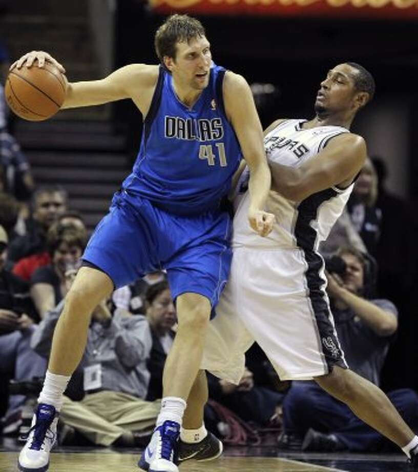 Boris Diaw gets the assignment to guard Dirk Nowitzki in the second half as the Spurs play the Dallas Mavericks at the AT&T Center in San Antonio on March 23, 2012.  Tom Reel/ San Antonio Express-News (TOM REEL / San Antonio Express-News)