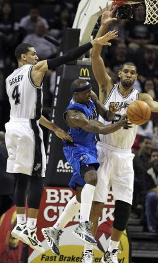 Tim Duncan and Danny Green stop Jason Terry in the lane in the second half as the Spurs play the Dallas Mavericks at the AT&T Center in San Antonio on March 23, 2012.  Tom Reel/ San Antonio Express-News (TOM REEL / San Antonio Express-News)