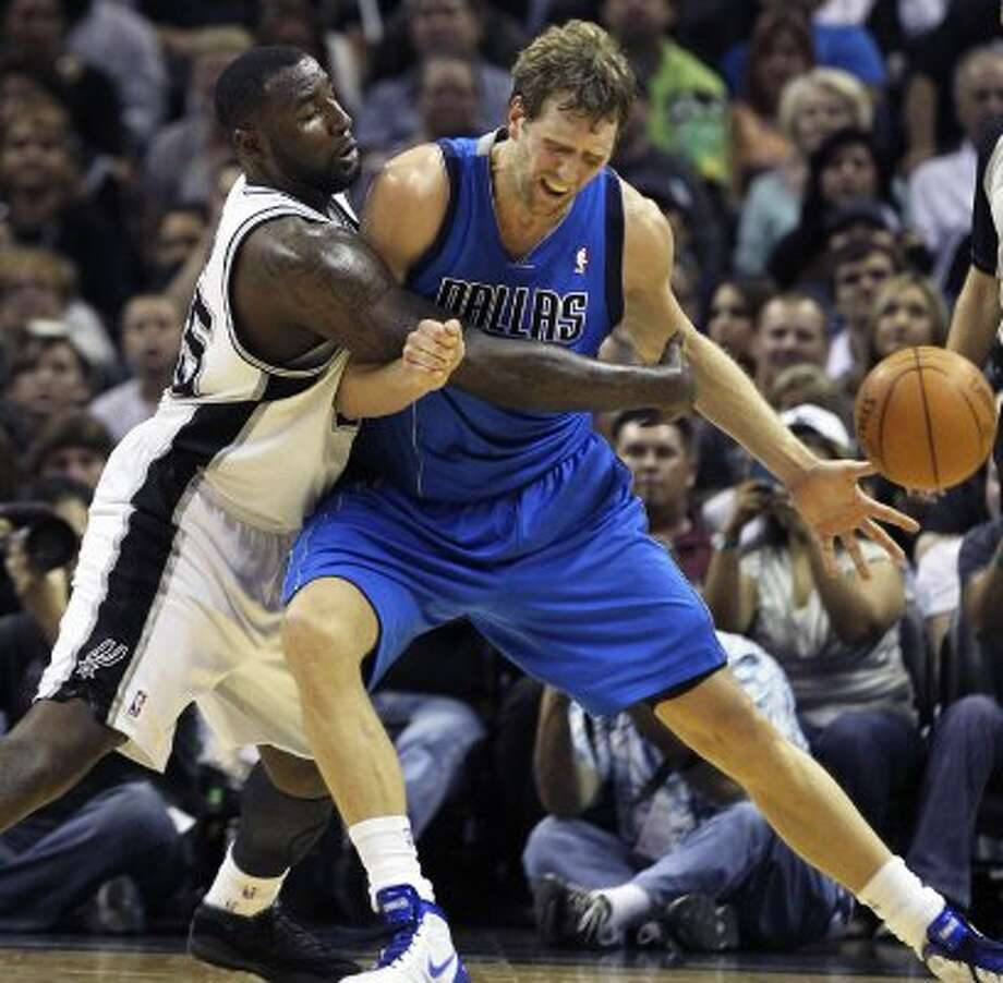 DeJuan Blair pressures Dirk Nowitzki in the first half as the Spurs play the Dallas Mavericks at the AT&T Center in San Antonio on March 23, 2012.  Tom Reel/ San Antonio Express-News (TOM REEL / San Antonio Express-News)