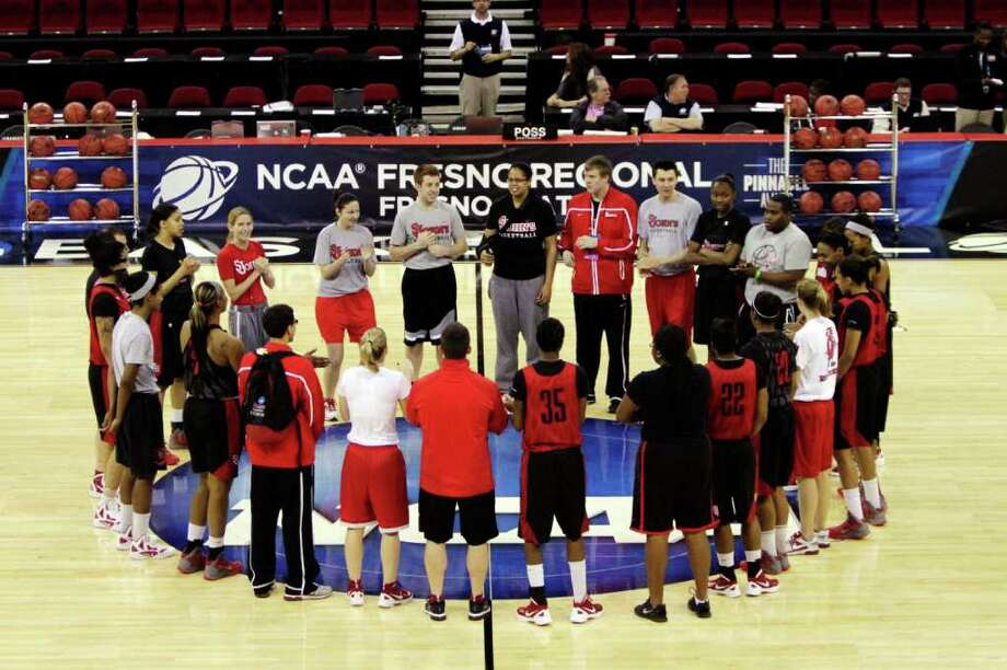 St. John's players meets at the start of practice, Friday, March 23, 2012, in Fresno, Calif. St. John's is scheduled to play Duke in a NCAA women's tournament regional semifinal college basketball game on Saturday. (AP Photo/Rich Pedroncelli) Photo: Rich Pedroncelli