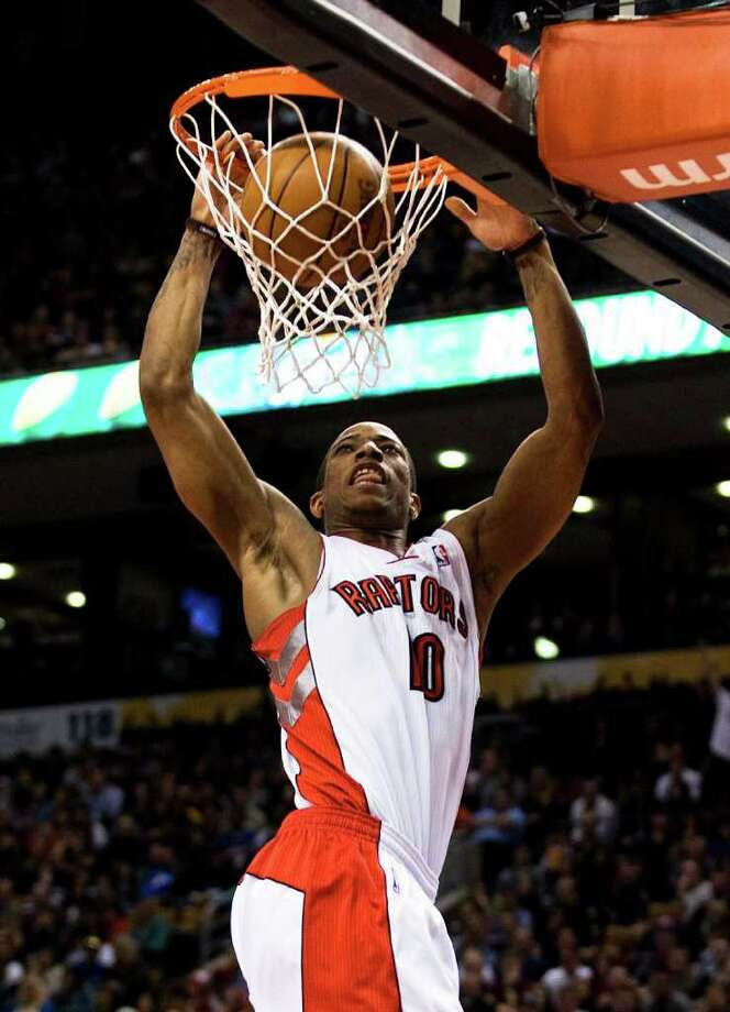 Toronto Raptors' DeMar DeRozan dunks against the New York Knicks during the second half of an NBA basketball game in Toronto on Friday, March 23, 2012. (AP Photo/The Canadian Press, Aaron Vincent Elkaim) Photo: Aaron Vincent Elkaim
