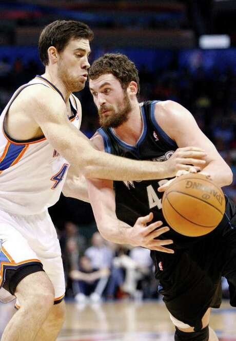 Timberwolves center Kevin Love, right, led all scorers with 51 points, but the Thunder came out with a 149-140 win in double overtime Friday night. Photo: Alonzo Adams / FR159426 AP