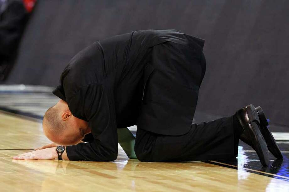 Ohio coach John Groce is overcome with emotion late in Friday night's loss to No. 1 seed North Carolina. Groce's 13th-seeded Bobcats gave the Tar Heels all they wanted before losing in overtime. Photo: Dilip Vishwanat / 2012 Getty Images