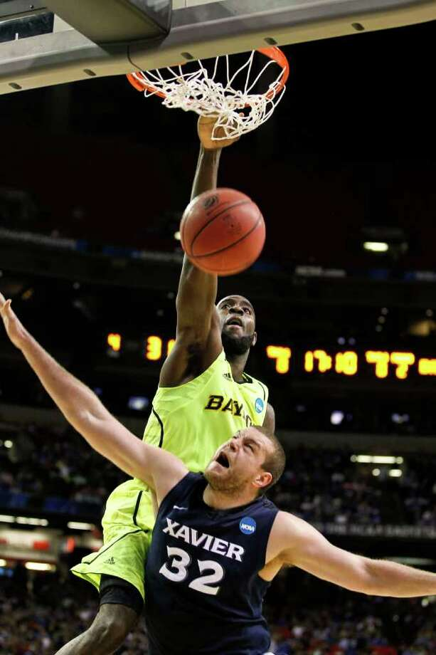 Baylor's Quincy Acy rattles the rim and Xavier's Kenny Frease on one of Acy's four dunks in the Bears' 75-70 victory in the South Region semifinals Friday night. Acy finished with 20 points. Photo: Mark Cornelison / Lexington Herald-Leader