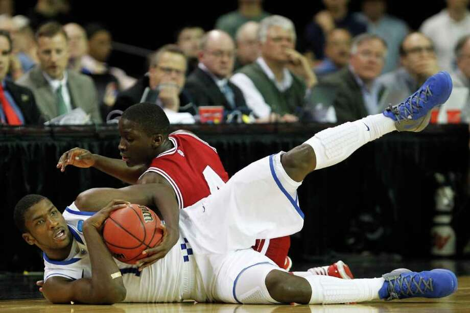 Michael Kidd-Gilchrist, front, and his Kentucky teammates found themselves in for a scrap against Victor Oladipo and Indiana on Friday night in the late South Regional game in Atlanta. Photo: Streeter Lecka / 2012 Getty Images