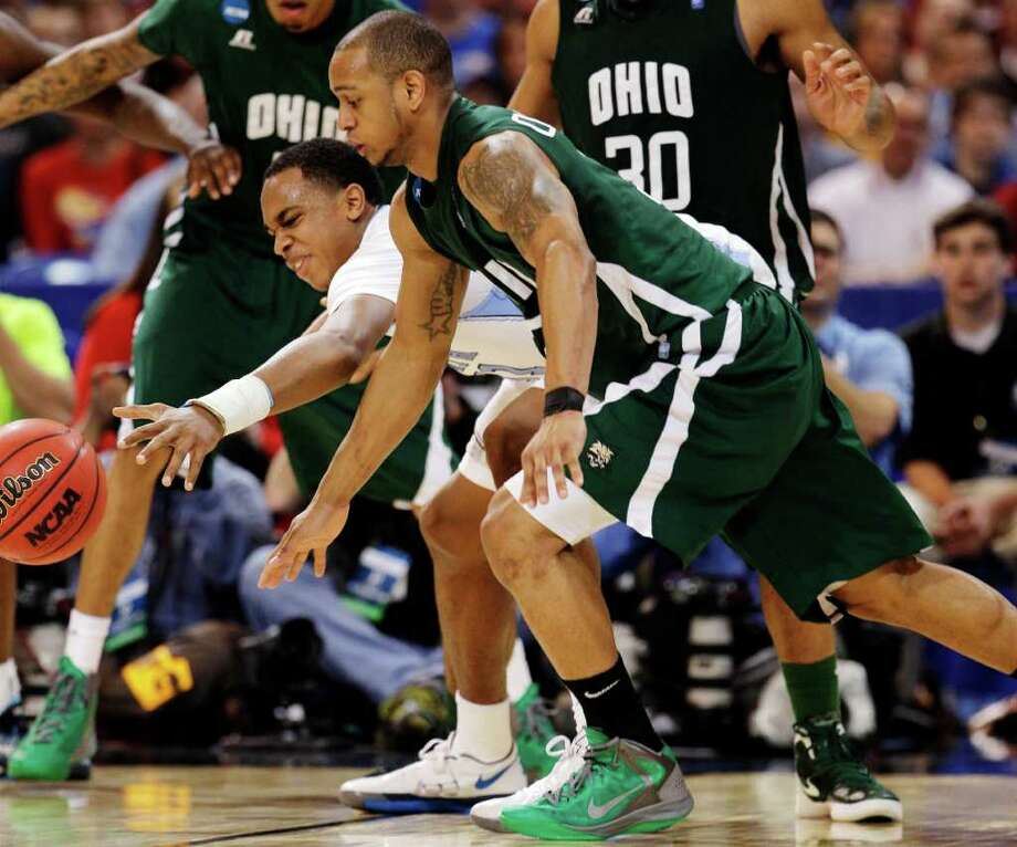 North Carolina forward John Henson and Ohio guard Walter Offutt (3) battle for a loose ball during the second half of an NCAA tournament Midwest Regional college basketball game, Friday, March 23, 2012, in St. Louis. (AP Photo/Charlie Riedel) Photo: Charlie Riedel