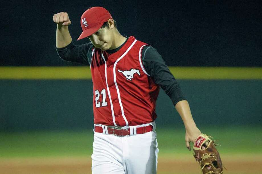 North Shore pitcher Ricardo Salinas pumps his first after the final out of the Mustangs 3-0 victory over Channelview in District 21-5 high school baseball action on Friday, March 23, 2012, in Galena Park. Photo: Smiley N. Pool, Houston Chronicle / © 2012  Houston Chronicle